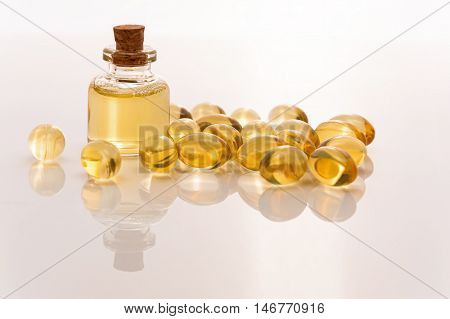 fish oil tablets and liquid omega 3 on a white background