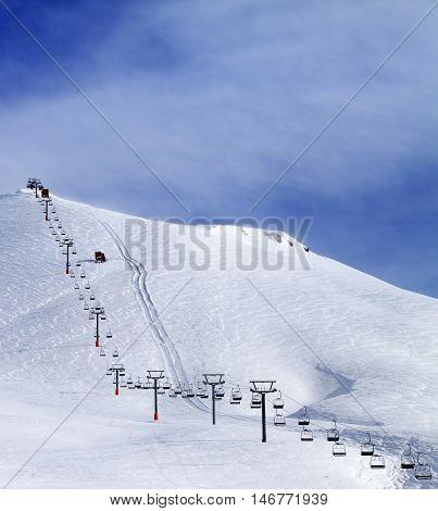 Ski Slope And Chair-lift At Morning