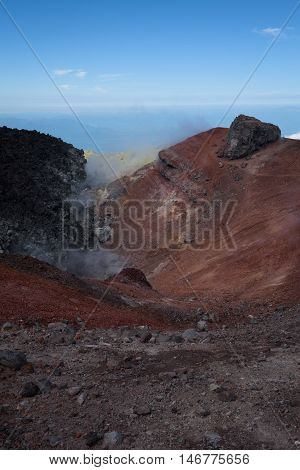 Smoking lava in the crater of the Avachinksy Volcano, Kamchatka, Russia. The lava raised to the top of the crater during the eruption in 2001.