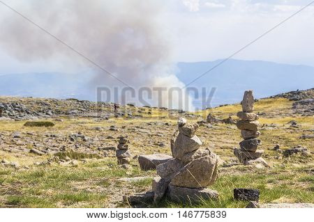 background view of  smoke fire and the view from the top of the hill in the nature reserve of Sierra de Eshtrella in Portugal