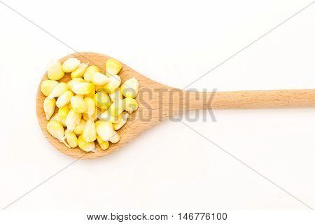Corn Kernels In Wooden Spoon, On White Background.