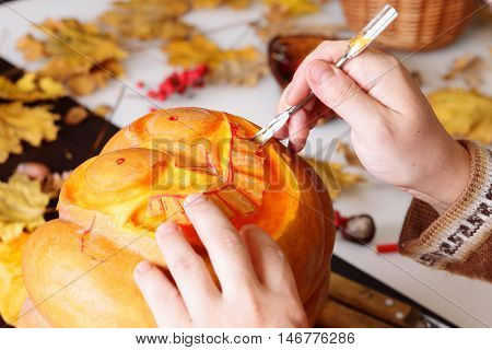 Process of carving out a pumpkin to prepare halloween lantern