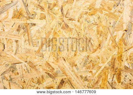 Oriented strand board (OSB) flakeboard texture background.