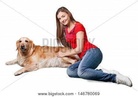 Portrait of cute lass embracing her fluffy dog while lying on grass