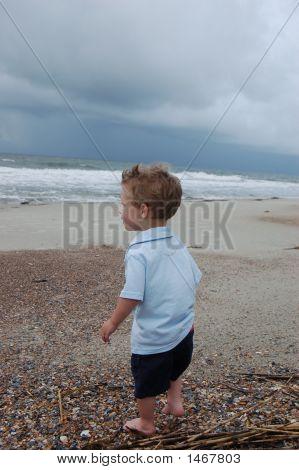 Boy Looking At The Ocean