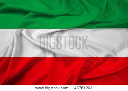 Waving Flag of North Rhine-Westphalia Germany, with beautiful satin background. 3D illustration