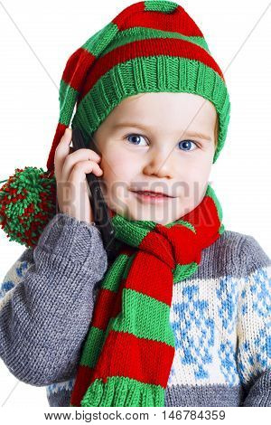 Christmas Boy In Knitted Cloths Makes A Phone Call To Santa Claus
