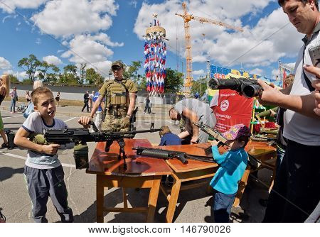 Boy Takes Aim With A Machine Gun