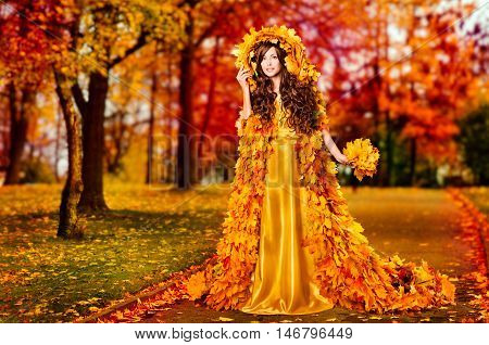 Autumn Woman Fall Leaves Dress Walking In Fairyland Forest Fashion Girl in Yellow Gown