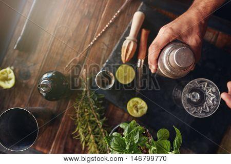 Barman Preparing Cocktail In Shaker