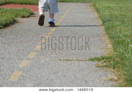 Boy Running Down The Road