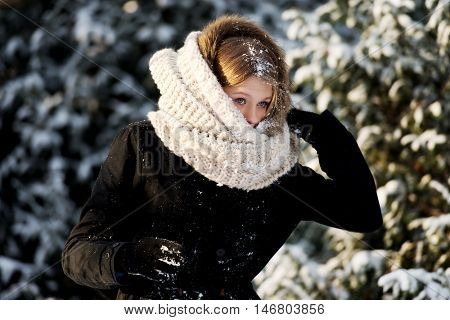 Young woman playing snowball fight