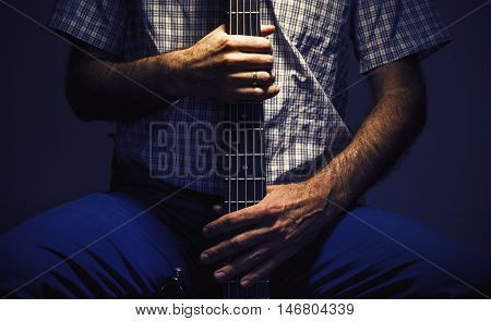 Bass Player And His Guitar