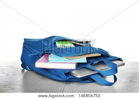Blue school backpack isolated on white