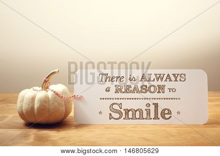 There Is Always A Reason To Smile Message With Small Pumpkin