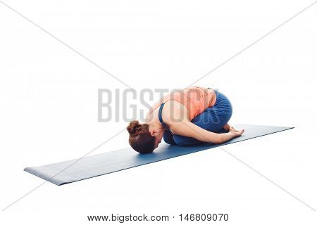 Woman doing Ashtanga Vinyasa Yoga relaxation asana Balasana - child posture - resting pose or counter asana for many asanas isolated on white background