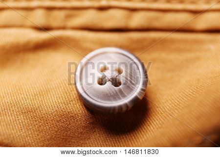Button on a cloth close up