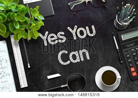 Yes You Can. Business Concept Handwritten on Black Chalkboard. Top View Composition with Chalkboard and Office Supplies. 3d Rendering. Toned Illustration.