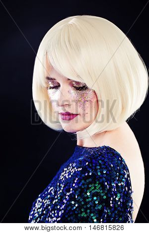 Beautiful Woman with Artistic Glitters Makeup and Blonde Hairstyle