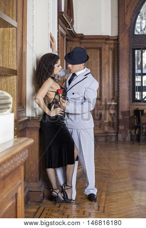 Tango Dancer Holding Rose While Looking At Partner