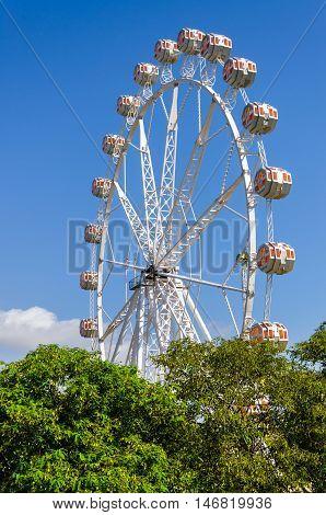 Big wheel in the park Turia in Valencia, summer Spain