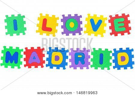 Message I Love Madrid from letters puzzle isolated on white background.