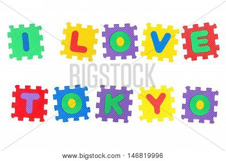 Message I Love Tokyo from letters puzzle isolated on white background.