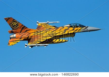 GILZE-RIJEN THE NETHERLANDS - SEP 7 2016: Special painted Belgian Air Force F-16 fighter jet making a fast flyby over the airbase