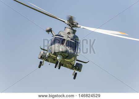 Military helicopter fliyng in the blue sky