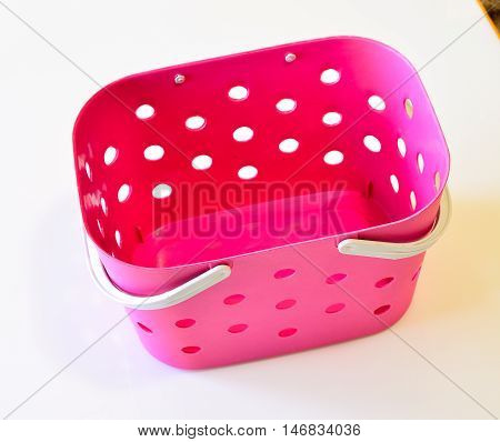 Empty Pink Platic Basket Isolated In Thailand