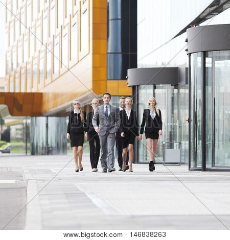 Group of business people walking in down town near office building