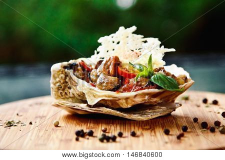 Spicy Mussel With Vegetables And Basil Served In A Large Shell