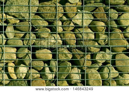 Pile of stone with metal grid. Abstract background and texture for design.