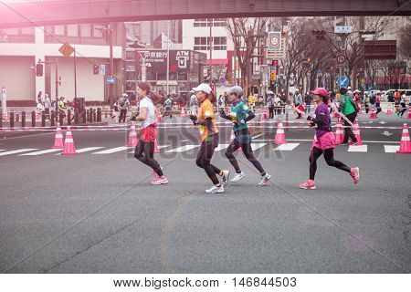 NAGOYA JAPAN - MARCH 13, 2016: Nagoya Women's Marathon 2016. Women's running in the downtown. Course Start and finish at Nagoya Dome Distance 42.195km. Nagoya city Japan.