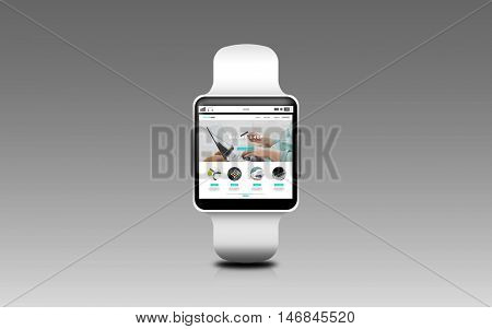 modern technology, object and shopping online concept - close up of smart watch with internet shop web page screen over gray background