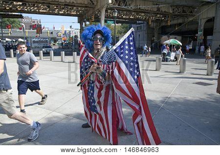 BRONX NEW YORK - SEPTEMBER 4: Lenny Lipschitz wears American flags before game at Yankee Stadium Taken September 4 2015 in New York.