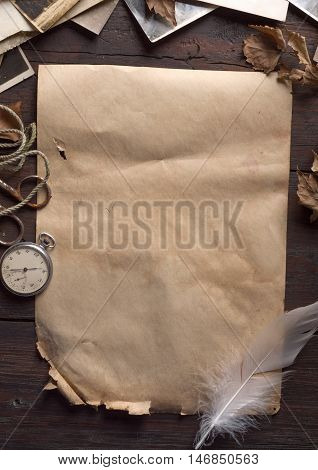 vintage background with old paper, clock and autumn leaves