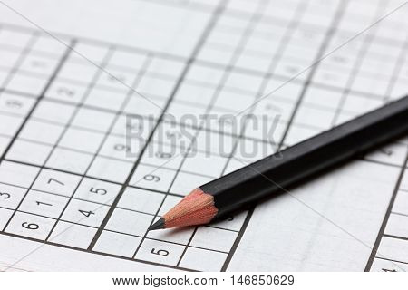 Crossword sudoku and pencil, popular puzzle game with numbers.