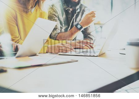 Coworkers Team Work Process Modern Interior Loft Office.Creative Producers Making Great Decisions New Idea.Young Business Crew Working Startup.Documents Wood Table.Analyze Reports.Blurred Film Effect