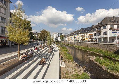 SIEGEN GERMANY - SEP 1 2016: New waterfront promenade at the Sieg river in the city of Siegen. North Rhine Westphalia Germany