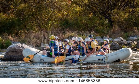 Village Mygiya, Nikolaev region, Ukraine - September 10, 2016: Rafting on the Southern Bug River. An experienced instructor holds the key to a great adventure. Rafting in Ukraine. Risky, bold action.