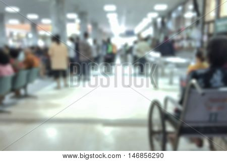 blurred hospital background, A lot of unidentified people and patient in hospital waiting medicine or doctor