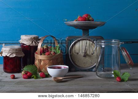 homemade strawberry preserve near the old wooden wall