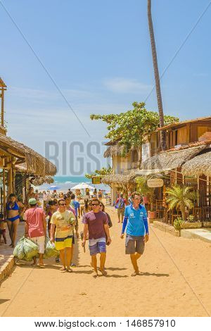 JERICOACOARA, BRAZIL, DECEMBER - 2015 - Crowded sand street with rustic style stores in Jericoacoara Brazil