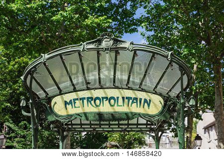 Paris France - July 06 2016: Retro subway sign at the entrance to the Abbesses subway station. It is a famous Art Nouveau symbol designed by Hector Guimard.