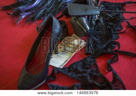 Prostitute Or Striptease Concept, 50 Euro Banknot With Sex Toys On Red Bedprostitute Or Striptease C