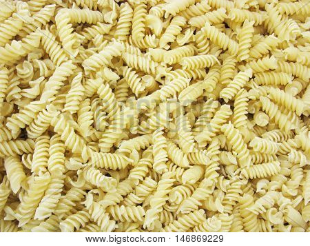 A lot of pasta. Dry pasta. Scattered pasta. Pasta as a background. Pasta background. Pasta products. Macaroni products. Food. Background.