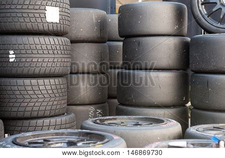 Many Sets Of Motor Sport Car's Slick And Wet Racing Tires