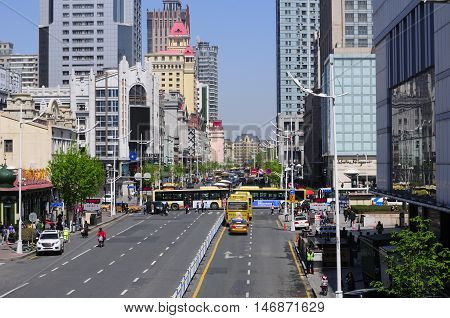 May 4 2016. Harbin China. Cars and buses moving down one of the busy streets within the city of harbin located in Heilongjiang province China.