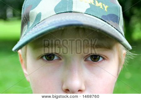 Teenager In A Military Cap
